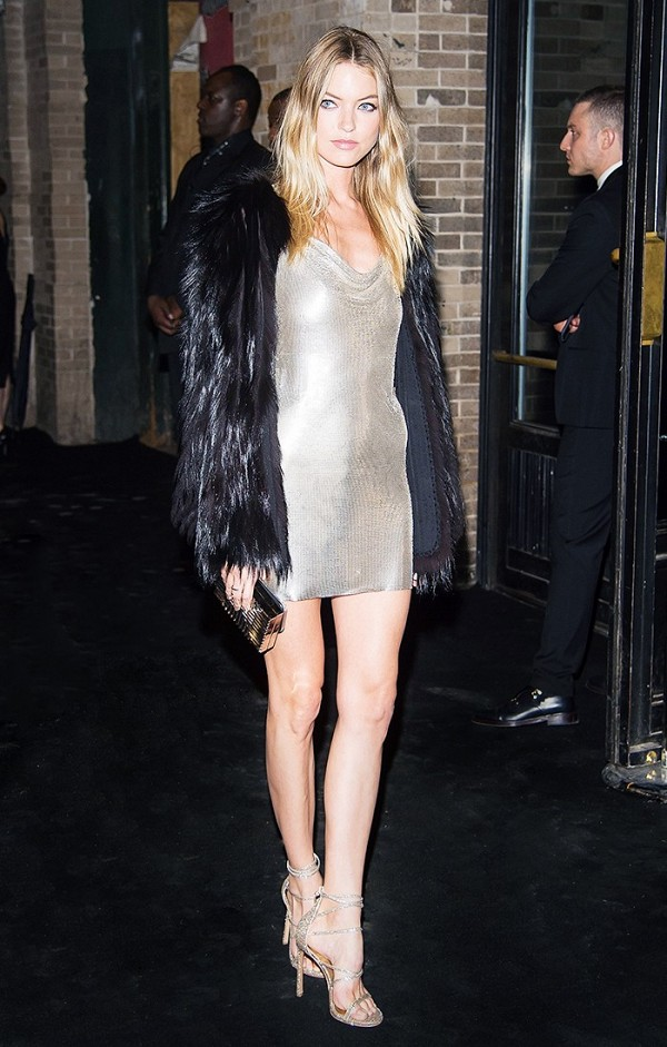 Model Martha Hunt attended a Met Gala afterparty in a slinky slip dress and strappy sandals. We love the furry jacket she layered on top, too!