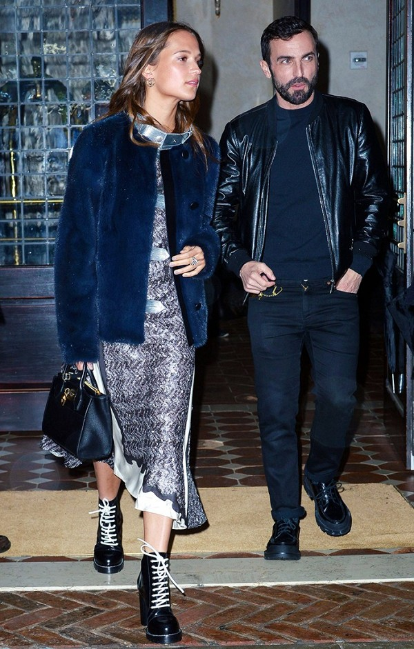 Alicia Vikander wore Louis Vuitton's F/W 16 gunmetal dress and grunge boots out to dinner and teamed the two with a furry coat.