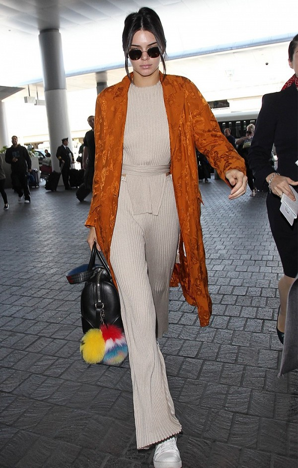 On Kendall Jenner: Elle Sasson Anouck Belted Sweater; Elle Sasson Bardot Sweater Pants; Fendi Smile Fur Pom-Pom Charm; Givenchy Lucrezia Holdall Bag ($2352); Kenneth...