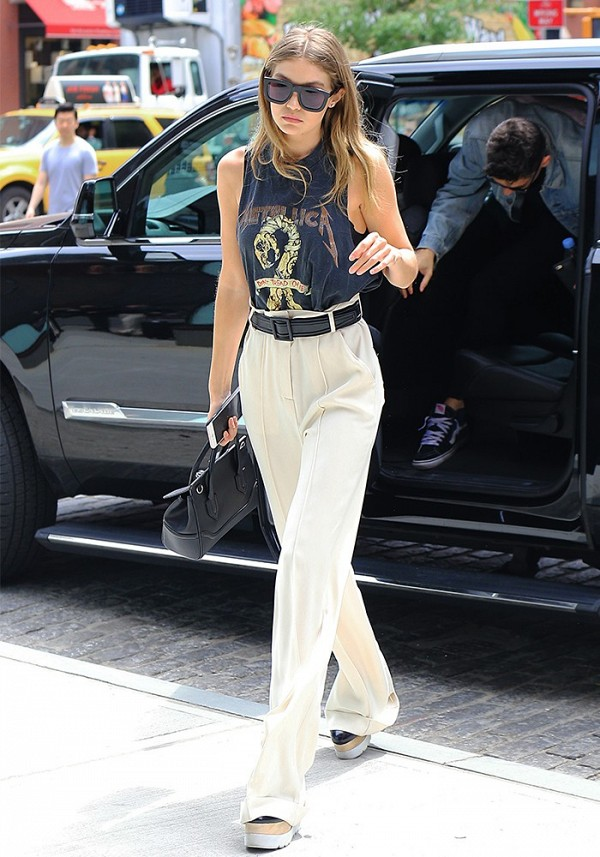 On Gigi Hadid: Karen Walker Deep Freeze Sunglasses ($250); Metallica Don't Tread on Me 1991 Tour T-Shirt; Versace Palazzo Empire Bag ($2150); Jeffrey Campbell Berliner Platform Oxfords...