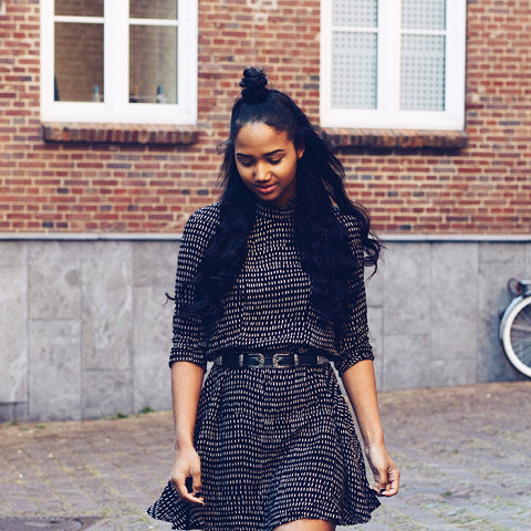 Add some sparkle to a simple dress with glitter boots.
