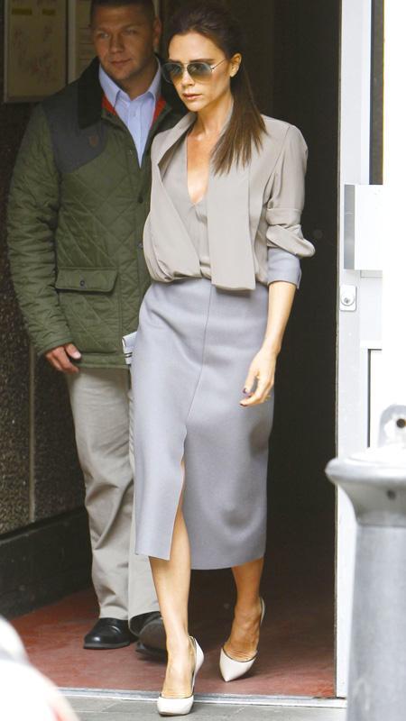 Victoria Beckham in skirt and beige blazer