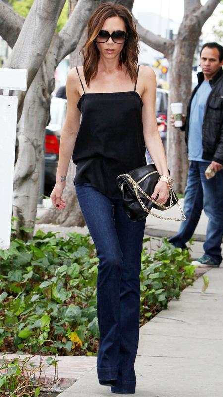Victoria Beckham in jeans and black tank top