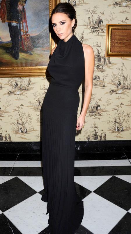 Victoria Beckham in black halter dress