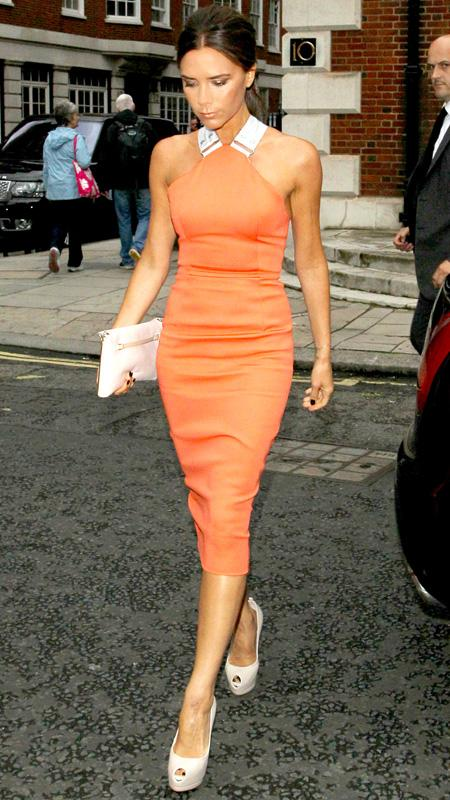 Victoria Beckham wearing orange dress and nude heel