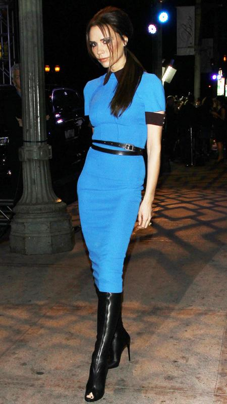 Victoria Beckham in blue dress with black trim and open-toe black boots