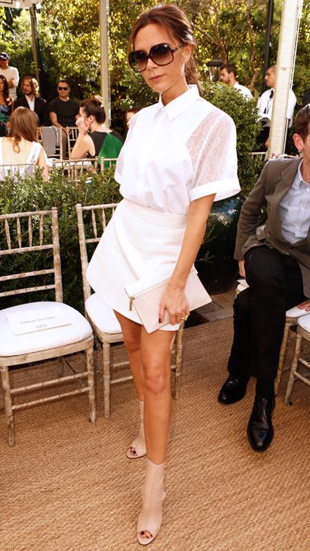 Victoria Beckham wearing white top and skirt