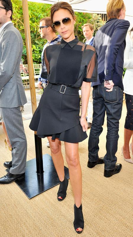 Victoria Beckham wearing black top and skirt with belt