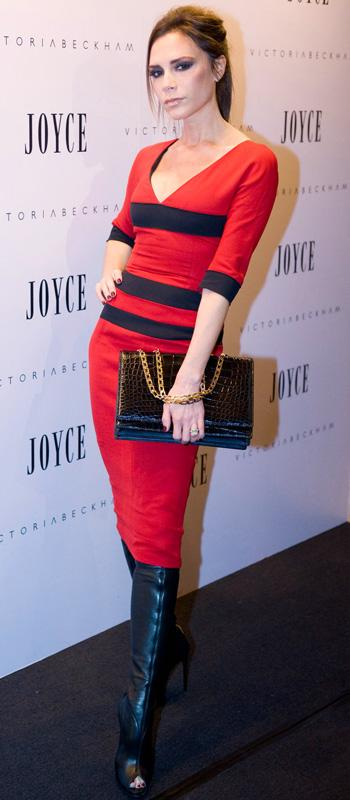Victoria Beckham in red dress with black horizontal stripes