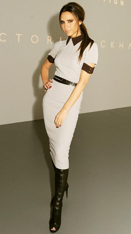 Victoria Beckham in beige dress with black trim and peep-toe boots
