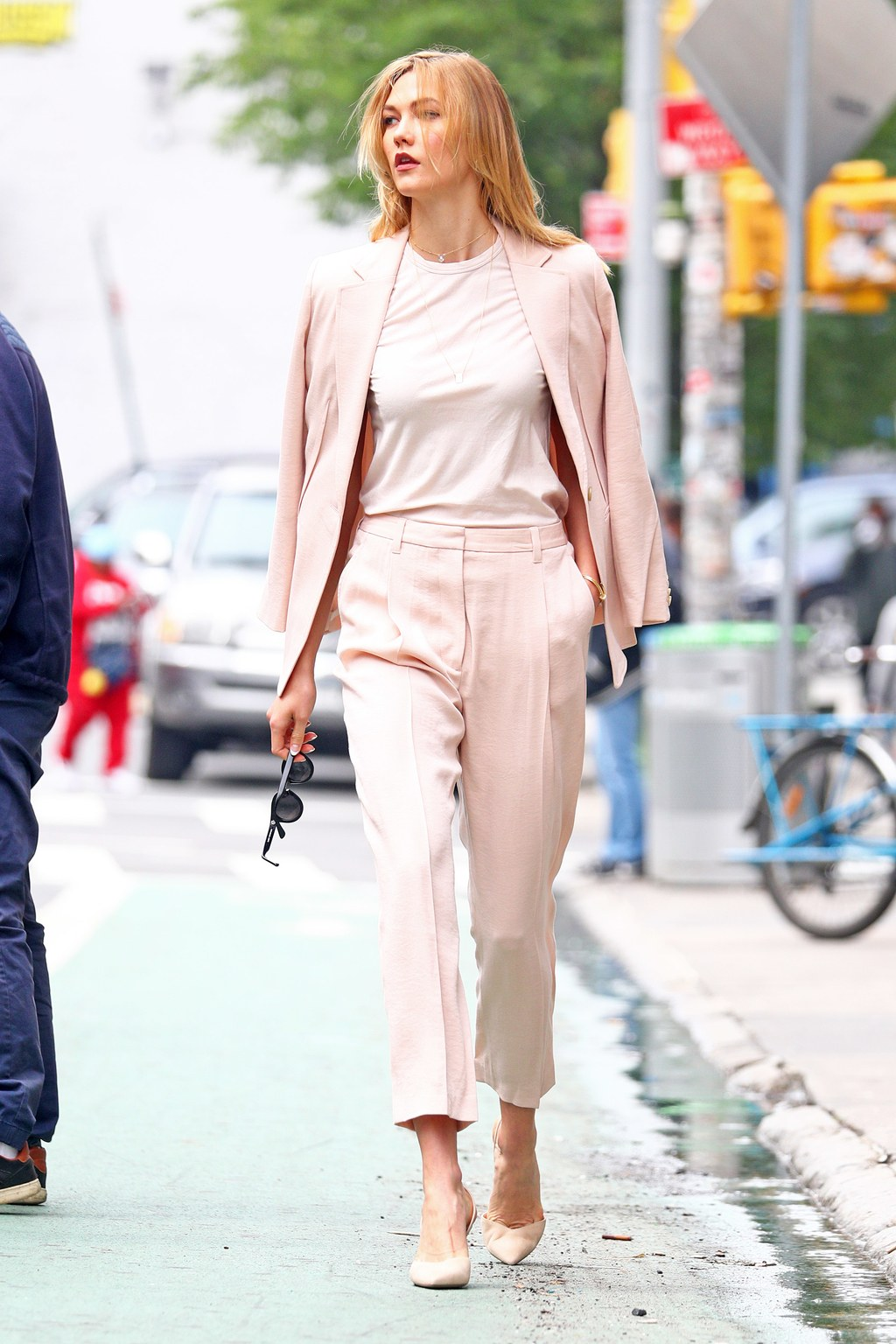 EXCLUSIVE: Karlie Kloss spotted wearing a pastel baby pink suit and T Shirt in NYC