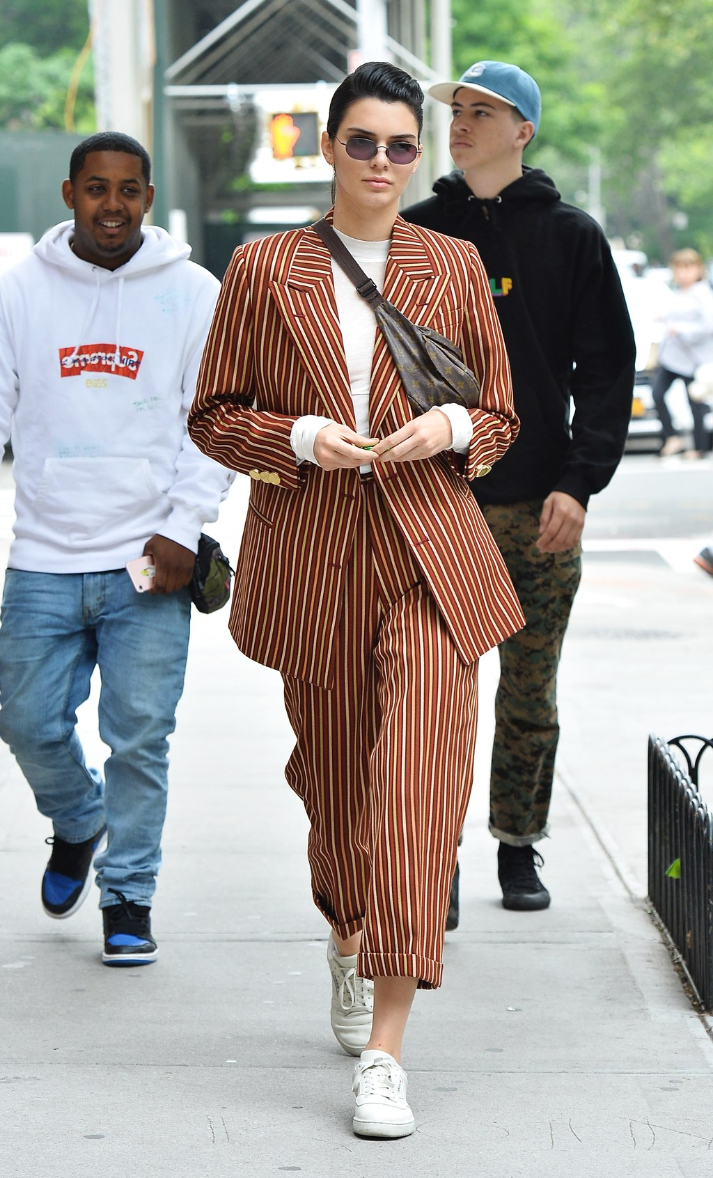 Kendall Jenner is all smiles as she takes a stroll rocking a pinstripe suit in SoHo, New York City